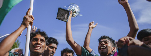 Indian boys celebrate after winning the 5th division title at the Homeless World Cup