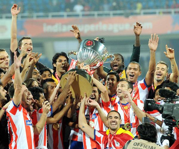Atletico de Kolkata with 2014 ISL trophy