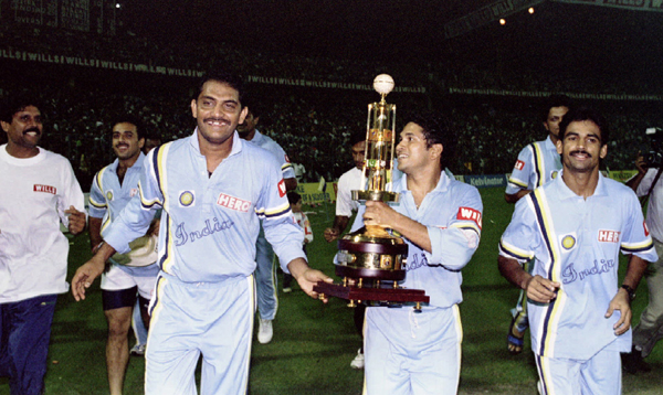 Sachin holding the hero cup trophy. Kapil is seen on left corner