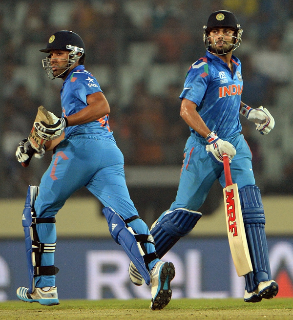 Kohli and Rohit running between the wickets