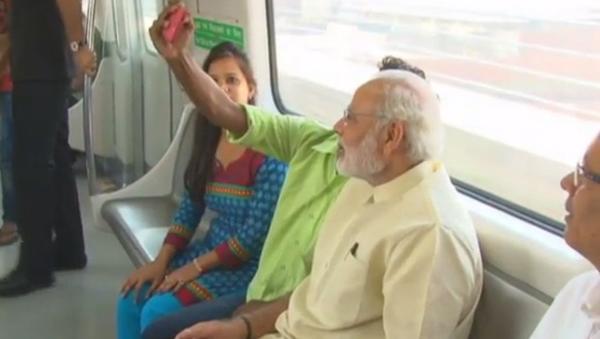 Passenger takes selfie with Modi on Delhi Metro
