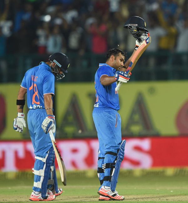 Rohit celebrates after reaching his hundred