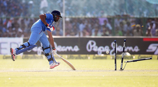 Rohit scampers through to the non-striker