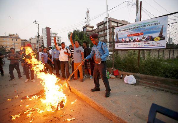 Nepal protests modi effigy