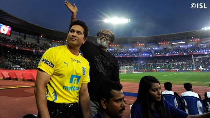 Sachin Tendulkar and Rajnikanth share a buggy ride during the 2015 ISL opening ceremony