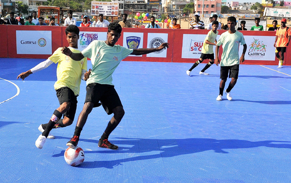boys playing the slumsoccer tournament