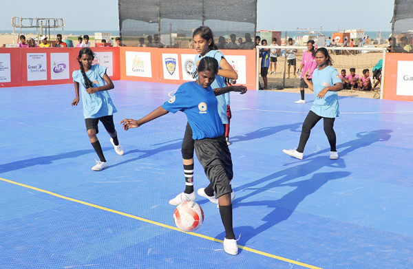 girls playing slum soccer tournament