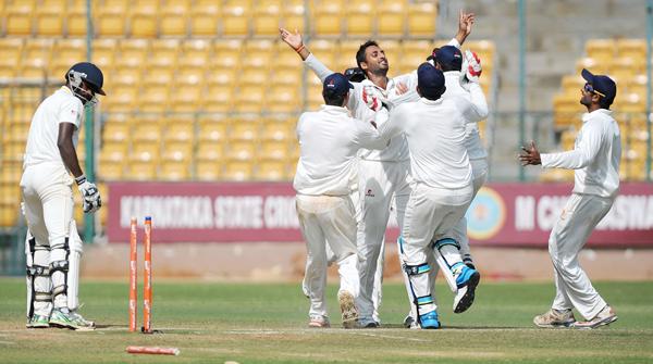 Sreenath Aravind celebrates a wicket in Ranji Trophy