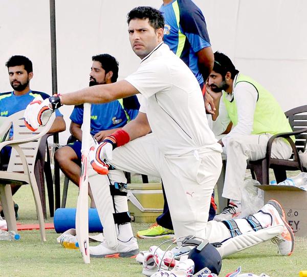 Yuvraj Singh warming up for Punjab
