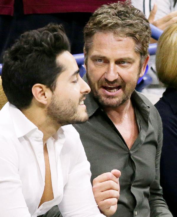 Gerard Butler (right) enjoying the US Open final