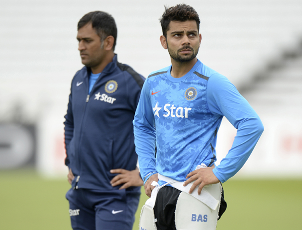 Dhoni with Kohli at a net session