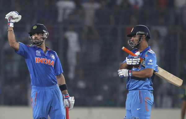 Kohli celebrates with Dhoni