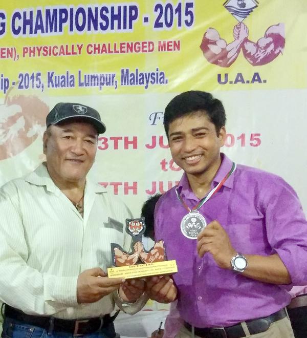 Laxman receiving his silver medal at national championship
