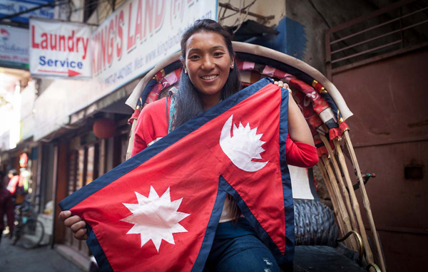A Nepalese woman with the national flag