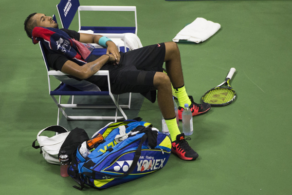 Nick Kyrgios resting during his US Open Round 1 match vs Andy Murray