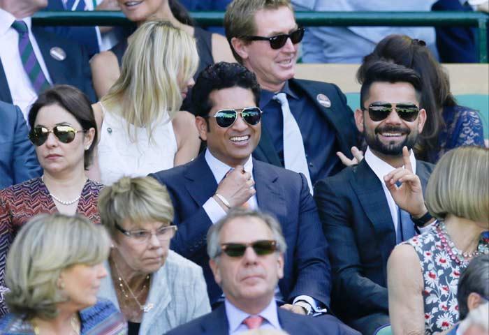 Kohli with Sachin watching Federer at Wimbledon