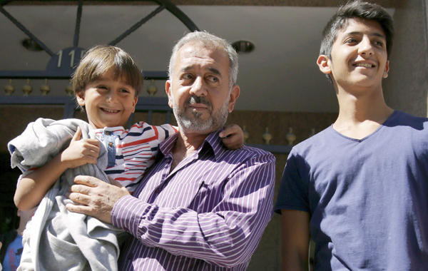 Osama Mohsen with his two sons
