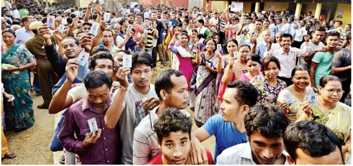 Voters lining up to vote in a polling station in Assam