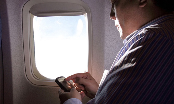 Active mobile phones in airplanes will interfere with the navigation and communications systems -– is deemed hazardous for safety and hence banned