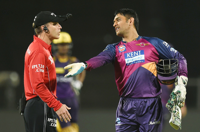 Dhoni with umpire