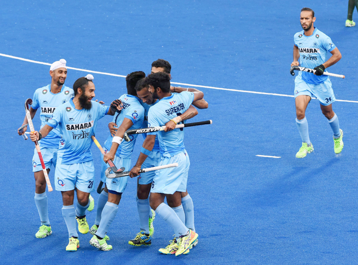 Indian hockey team celebrates a goal