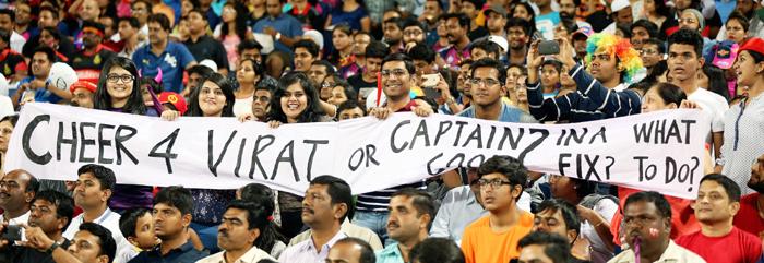Kohli vs Dhoni banner
