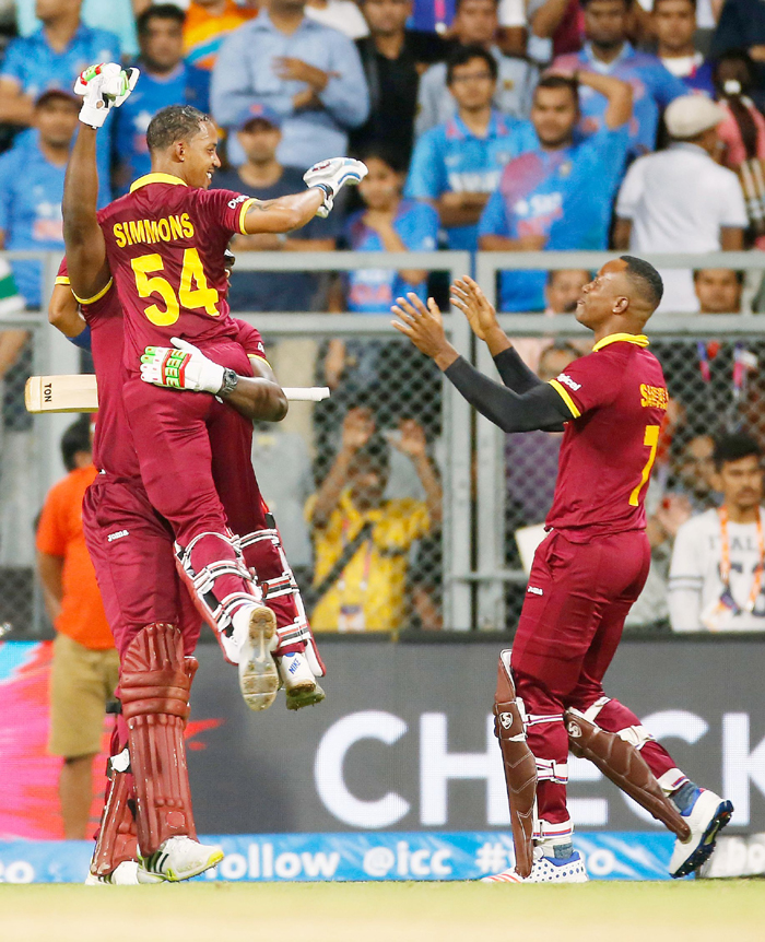 Lendl Simmons lifted up by Andre Russel