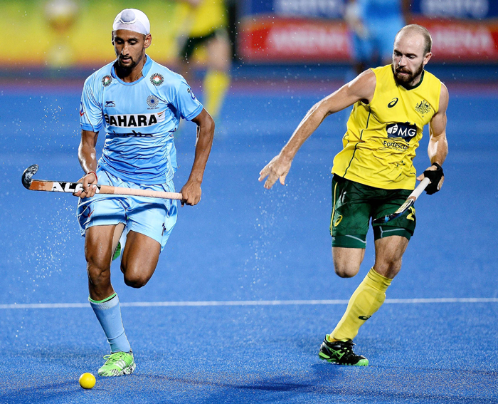Mandeep vying for the ball
