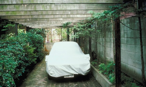 Car with tarpaulin cover