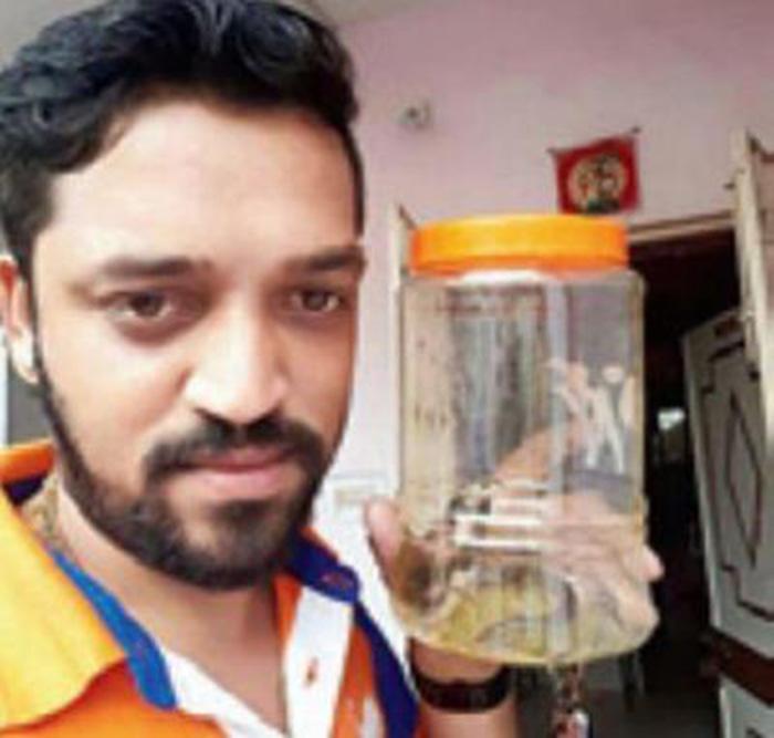 A man who took selfie with cobra