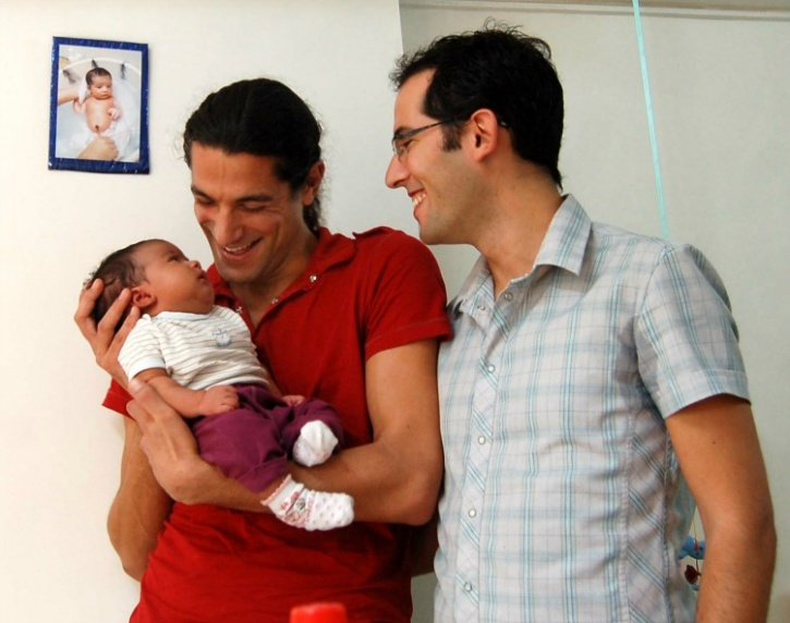 Israeli couple with their surrogate child