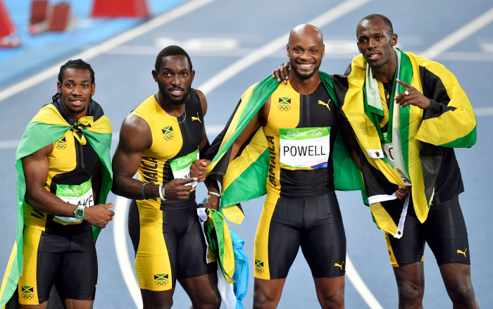 Bolt (right) with his Jamaican teammates
