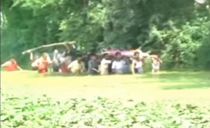 Madhya Pradesh Villagers Forced To Carry Dead Body Through A Pond