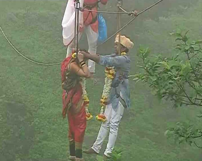 The Kolhapur bride and the groom - who had met and fallen in love while trekking - hung from a ropeway and went about their nuptials like it was no big deal.