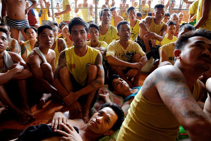 Inmates watch a movie at Quezon City Jail in Manila