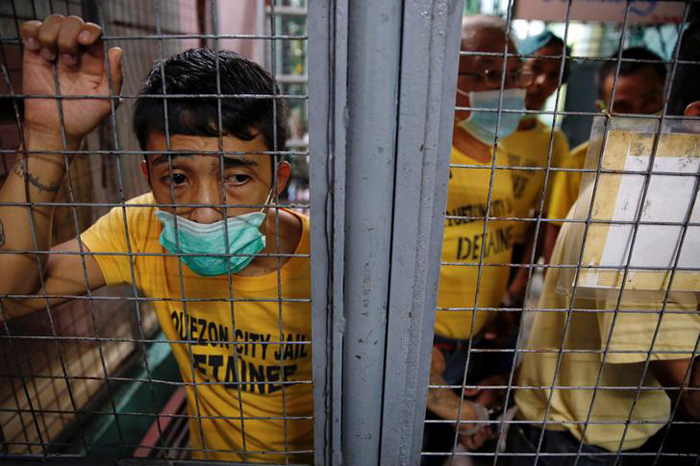 Inmates wait to be taken from Quezon City Jail to court hearings in Manila, Philippines.