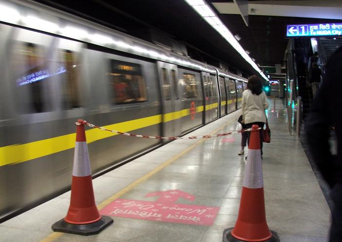 Delhi Metro Axe woman