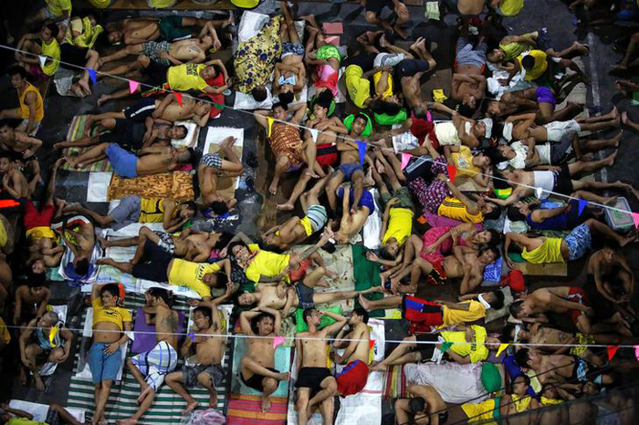 Inmates sleep in the open at Quezon City Jail in Manila