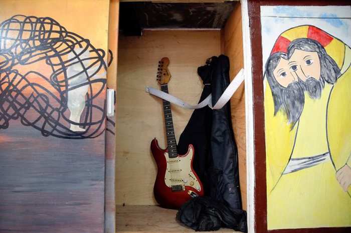 A guitar is placed inside a closet at the chapel of Quezon City Jail