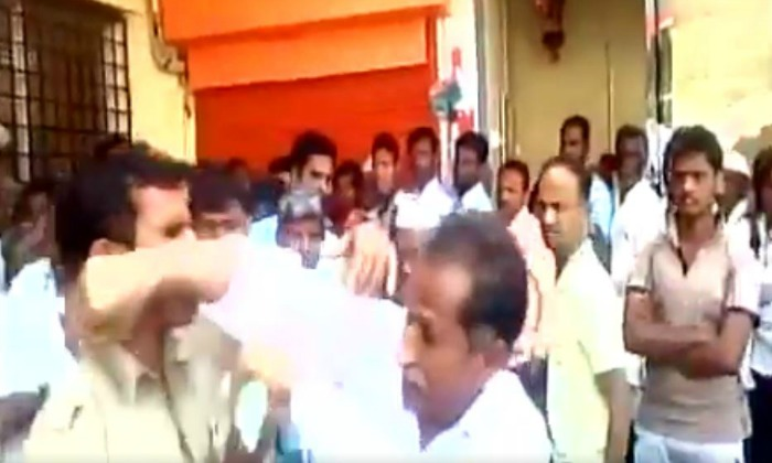 Ex-Serviceman Standing In Bank Queue Manhandled By Policeman