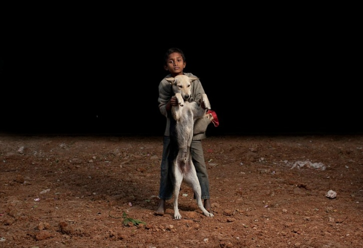 Orphaned kids forming families with dogs