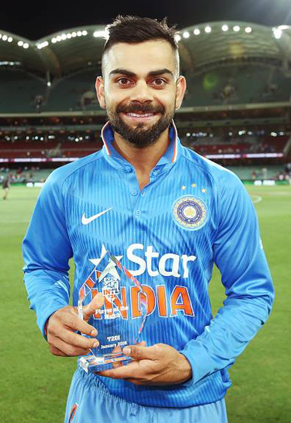 Kohli with the Man of the Series trophy