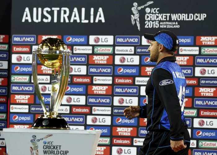 McCullum walks past the World Cup trophy