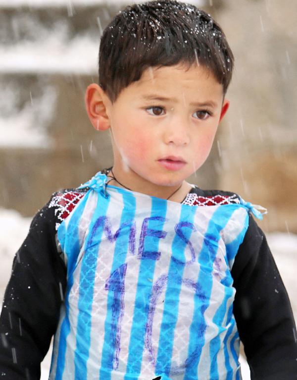 Murtaza Ahmadi in homemade Messi shirt