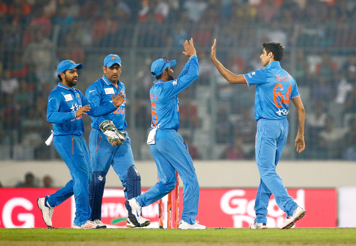 Nehra celebrates with the team