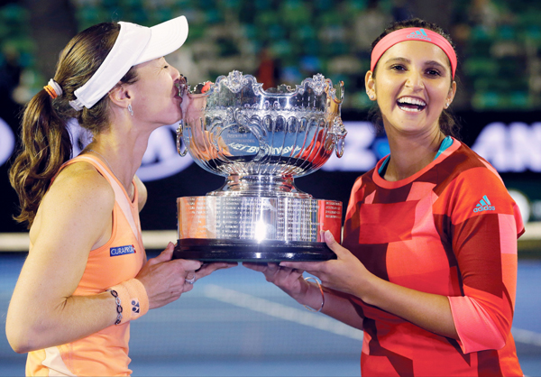 Sania and Hingis with the Australian Open trophy