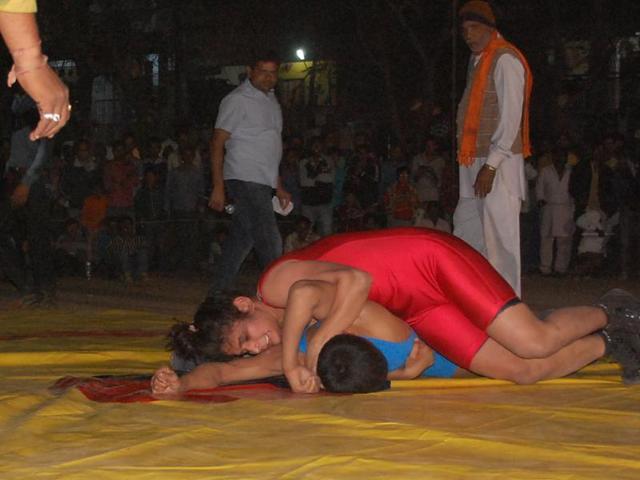 women wrestler defeats male wrestler