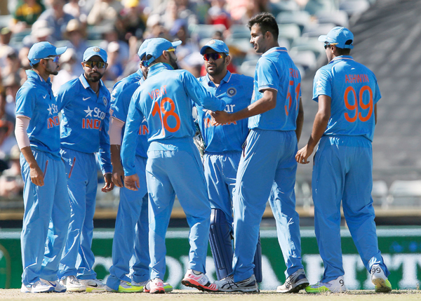 Barinder Sran (tallest) took three wickets for India on his international debut