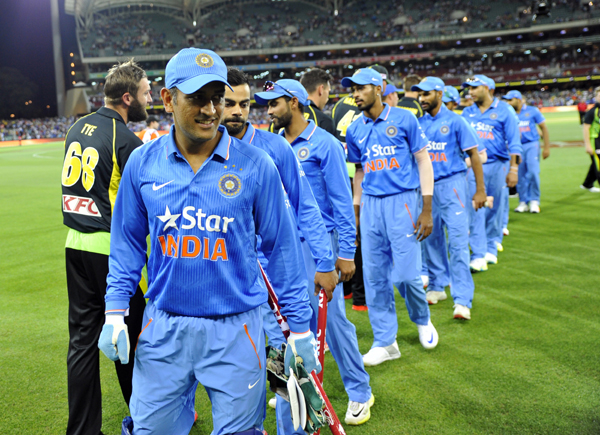 Dhoni leads the team out