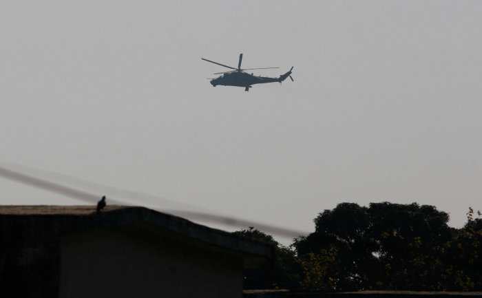 An Indian air force chopper on a reconnaissance mission flies over the Indian airbase in Pathankot